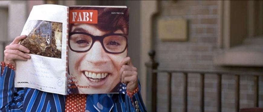 IMAGE: Still - Austin reading magazine