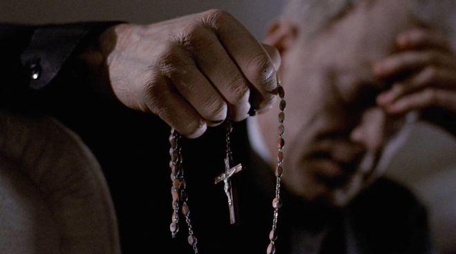 IMAGE: Still - Merrin and rosary