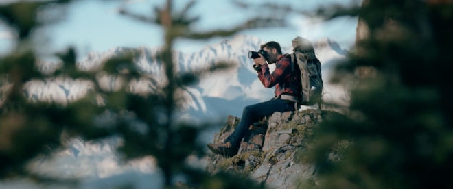 IMAGE: Still – Rack focus through trees, Mike on the edge of the cliff
