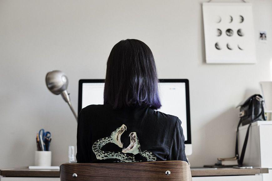IMAGE: BTS - Joyce Ho working at desk