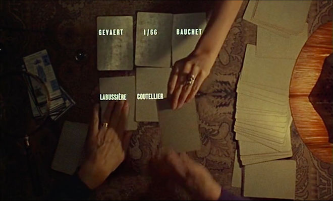 IMAGE: Still - 02 Two hands dealing cards with credits