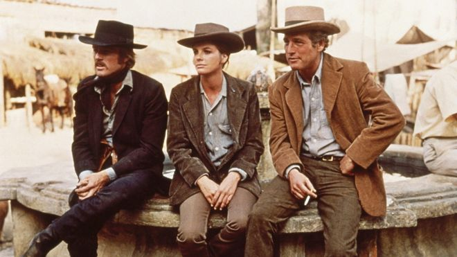 IMAGE: Robert Redford as the Sundance Kid, Katharine Ross as Etta Place, and Paul Newman as Butch Cassidy