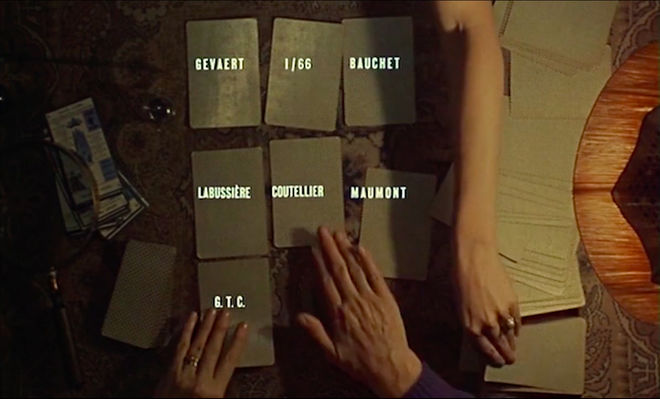 IMAGE: Still - 03 Two hands dealing cards with credits