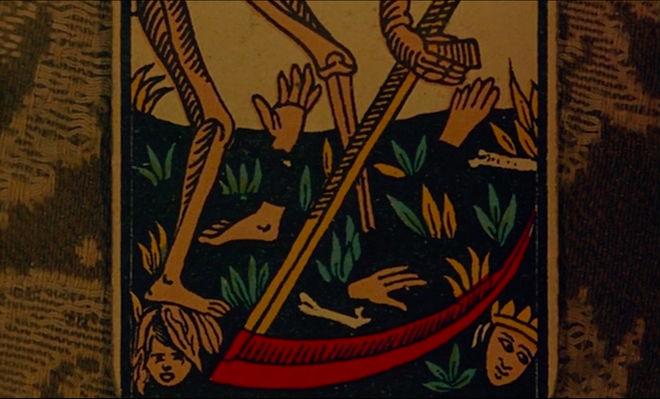 IMAGE: Still - Close up death card scythe