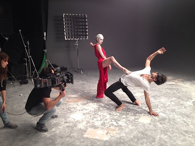 IMAGE: Dancers behind-the-scenes, in the red dress