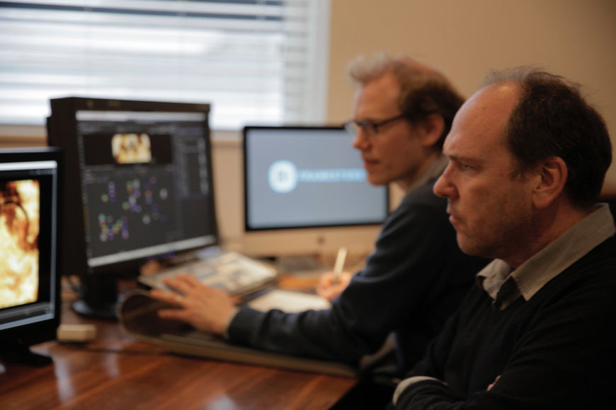 IMAGE: Kleinman and Bartlett working at Framestore in front of computers